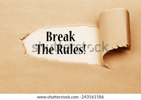 Break the Rules!  written behind torn paper - stock photo