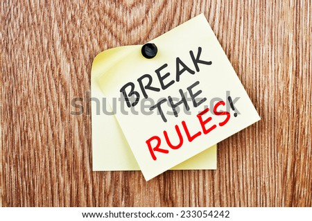Break the Rules! written on a note paper  - stock photo