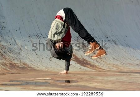 Breakdancer dancing in the street - stock photo