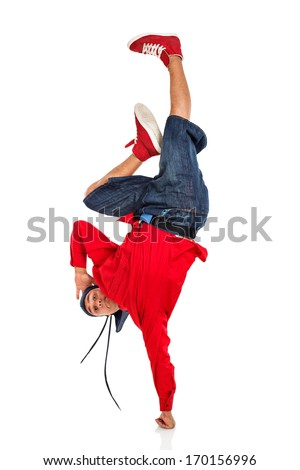 Breakdancer doing hand stand - stock photo