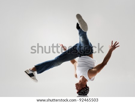 breakdancer frozen in mid head spin, classic modern hip hop or break dance move - stock photo