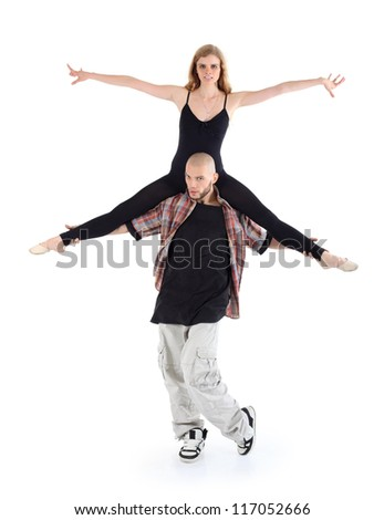 Breakdancer keeps on shoulders ballerina and poses isolated on white background. - stock photo