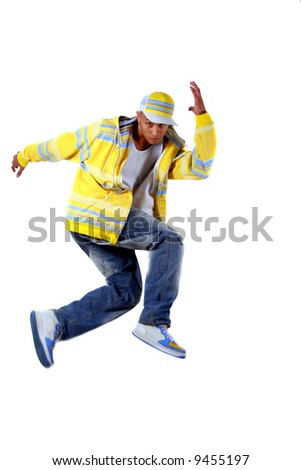 Breakdancing Young man with clothes in hiphop style showing a dance move while jumping over pure white background. Motion blurriness is intended!