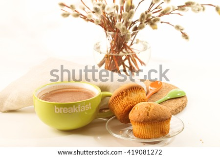 Breakfast: a cocoa cup, biscuits, willow branches in a vase. A linen napkin and a support from a stopper on a white background - stock photo