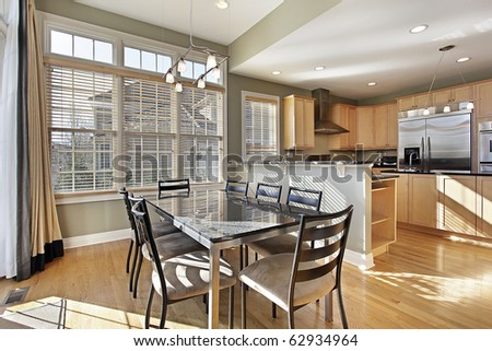 Breakfast area in luxury home with wood cabinetry - stock photo