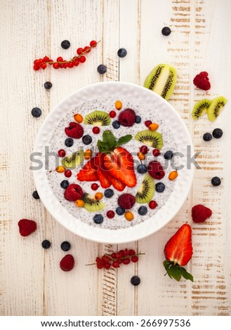 Breakfast bowl: coconut chia pudding with fruits,berries and vanilla . - stock photo