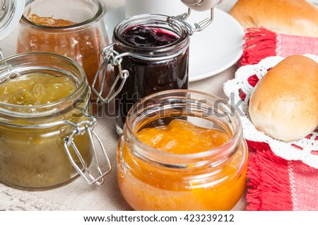 Breakfast bread rolls and jams