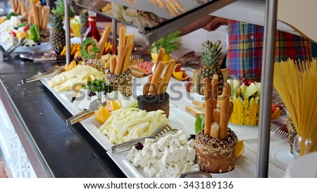 Breakfast Buffet in Luxury Restaurant. Buffet Catering Food Arrangement on Table. People Serving at Buffet. All inclusive. - stock photo