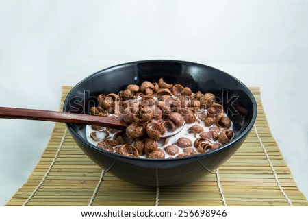 Breakfast - cereal with milk chocolate - stock photo