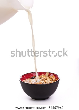 Breakfast cereal with milk pouring on top - stock photo