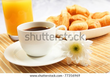 Breakfast coffee and croissants on a table on a light background. - stock photo