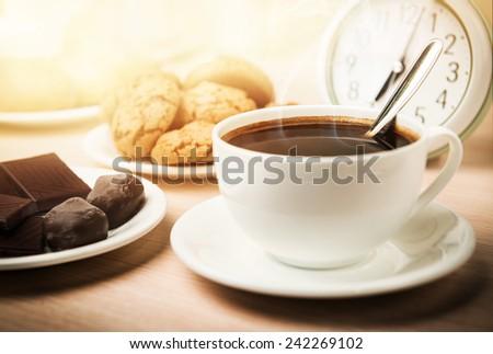 Breakfast. Coffee, chocolate and cookies. - stock photo