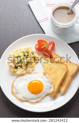 Breakfast coffee, fresh fried egg and scrambled egg with bread - stock photo