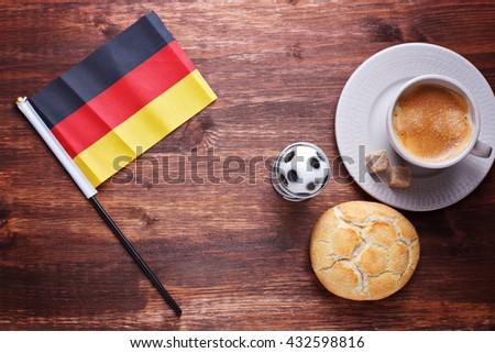 Breakfast connected to football: egg, bun, german flag. coffee - stock photo