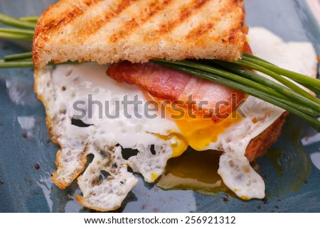 Breakfast, eggs, bacon and toast.selective focus - stock photo