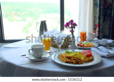 Breakfast for two in a hotel room - stock photo