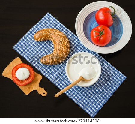 Breakfast. Grain Bagel with Cream Cheese and Tomatoes - stock photo