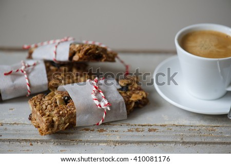Breakfast granola bars and coffee - stock photo