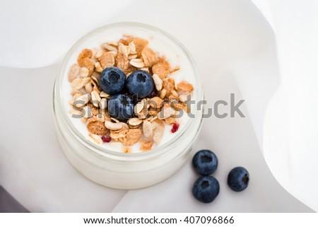 breakfast, healthy breakfast, breakfast of yogurt, breakfast of granola, breakfast of berries, blueberries breakfast - stock photo