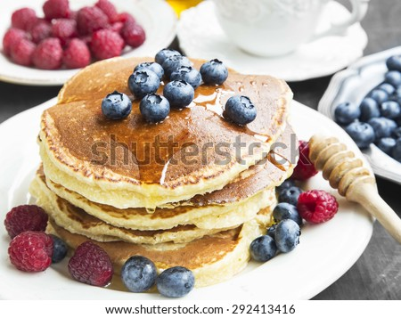 Breakfast Honey Pancakes with Blueberries and Raspberries,Sweet Breakfast - stock photo