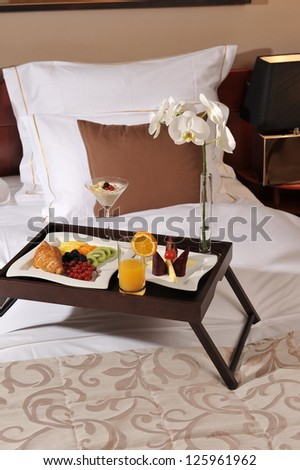 Breakfast in bed at a hotel room / Luxury hotel - stock photo
