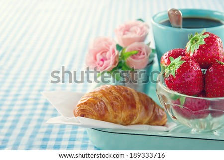 Breakfast in bed - mother's day tray with food and flowers - stock photo
