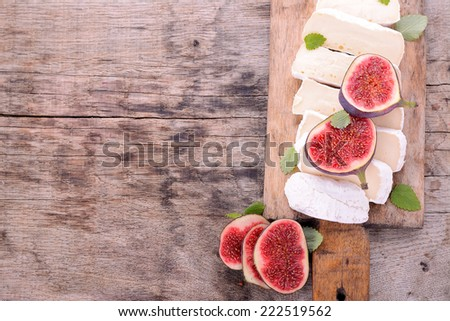 Breakfast in the garden goat cheese with figs and honey - stock photo
