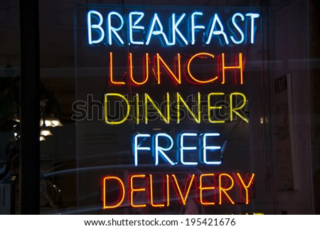 Breakfast, Lunch, Dinner neon sign in a New York City diner - stock photo