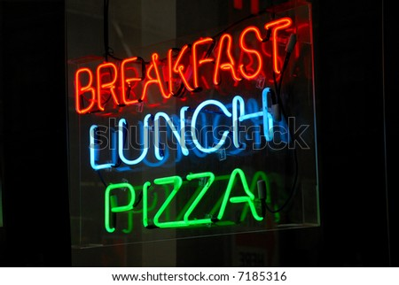Breakfast - Lunch - Pizza neon sign at night - stock photo