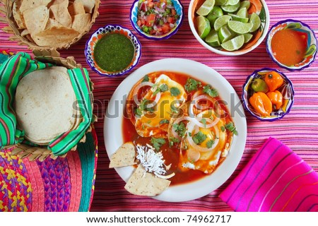Breakfast Mexican ranchero eggs with chili and nachos Mexico flavor - stock photo