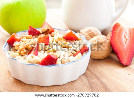 Breakfast: muesli, nuts and fruit - stock photo
