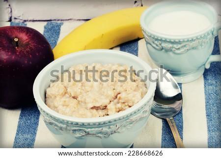Breakfast Oatmeal apple banana milk mug saucer tableware morning health - stock photo