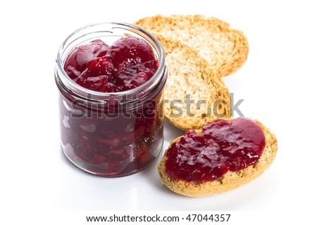 Breakfast of cherry jam on toast - stock photo
