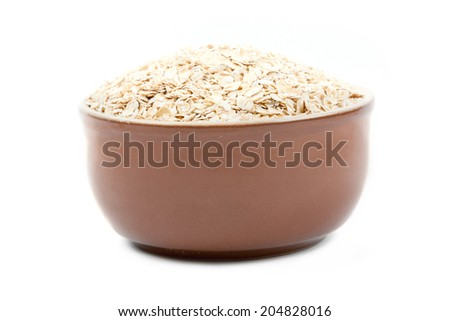 Breakfast of oatmeal flakes  - stock photo