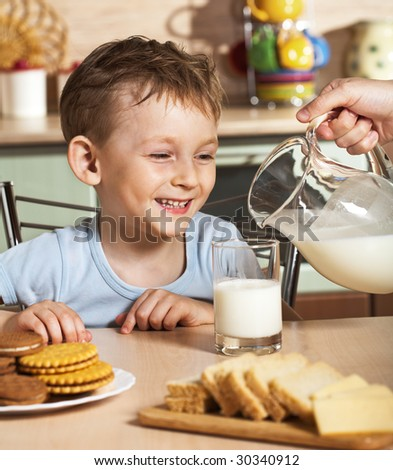Breakfast of the little boy - stock photo