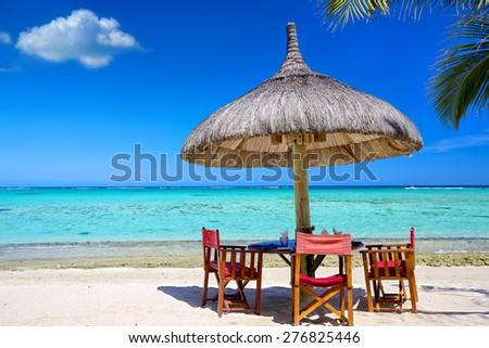 Breakfast on tropical white sand beach, Mauritius Island
