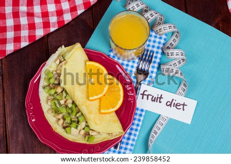 Breakfast Pancakes with fruit and fresh orange juice. Dietary calorie breakfast with fruit and juice. The concept of dumping excess weight. Healthy eating. - stock photo