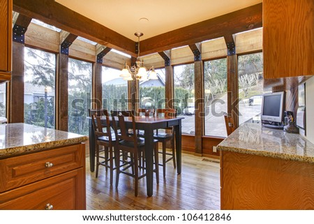 Breakfast room with wood floor and cherry cabinets. - stock photo