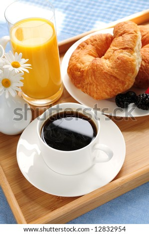 Breakfast served on a tray on a sunny morning - stock photo
