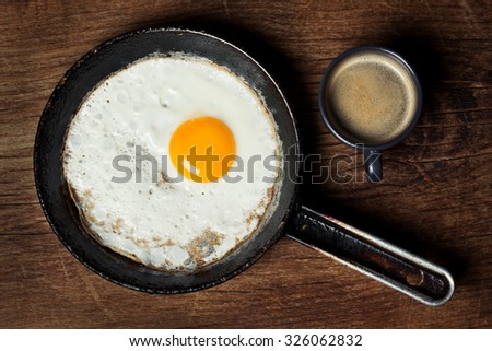 Breakfast setting with coffee and fried egg - stock photo