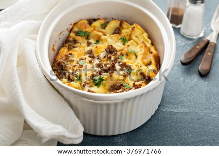 Breakfast strata with cheese and sausage in baking dish - stock photo