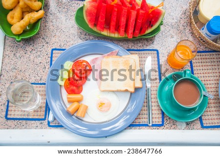 Breakfast table many food ,fresh fruits,watermelon and coffee - stock photo