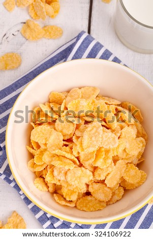 Breakfast table with cornflakes cereal - stock photo