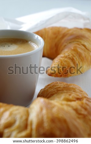 breakfast table with croissant and coffee
