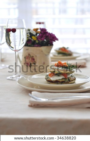 Breakfast Table with spinach  pancakes with smoked salmon