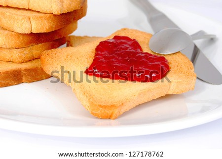 Breakfast toast with red heart jam symbol on white plate. Love concept.Romantic good morning breakfast.Unusual.Valentines day. - stock photo