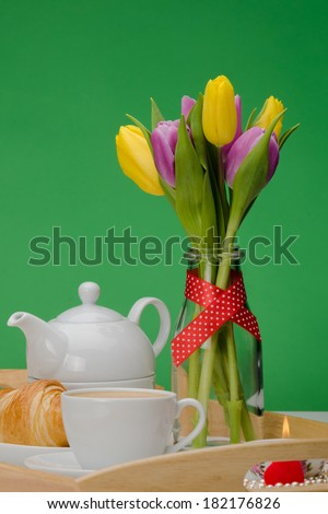 Breakfast tray with  yellow and pink  mauve tulips  - stock photo