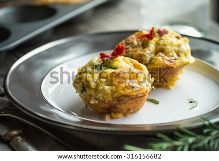 Breakfast treat with savory egg muffin bites with sundried tomato - stock photo