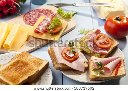 Breakfast with a toasted bread, sausage and cheese.  - stock photo