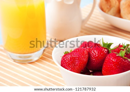 Breakfast with berries,orange juice and croissant, early breakfast - stock photo